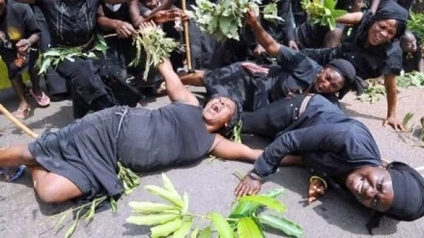 Women Protesting And Crying In Black Uniform