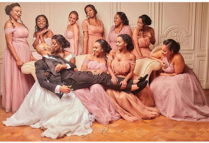 Bride Carries Groom On Her Laps, Bridesmaids Hold His Legs For Her To Kiss Him (Pic)