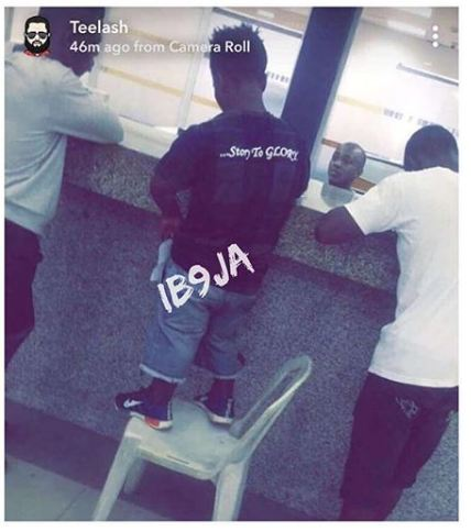 Short Man Climbs Chair At First Bank Ikotun, Lagos To Transact Business- Picture