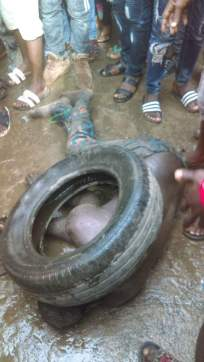 baby-kidnapper-caught-in-lagos-almost-burnt-to-death-with-tyre-by-angry-mob