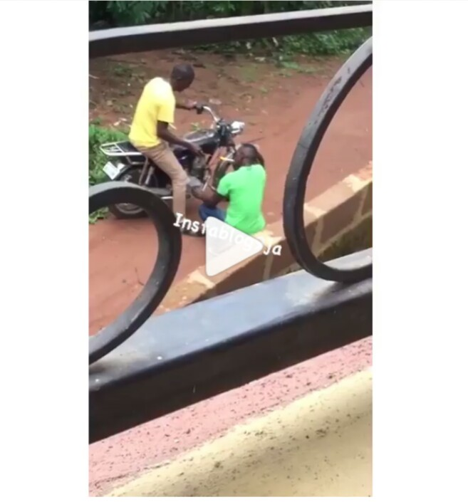 Two Men Use A Bike To Light Up Their Weed In Enugu (Photos)